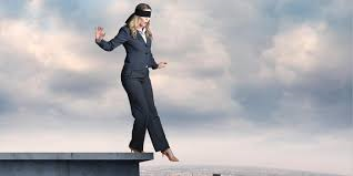 woman stepping off ledge